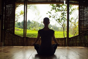 Woman meditating at resort in Bali