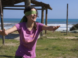 Young Woman Playing Blindman's Buff