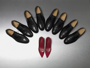 Row of Dress Shoes Surround High Heels